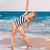 beautiful little girl excercising on the beach stock photo © len44ik