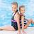 two cute little girls in swimming pool stock photo © len44ik