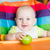 adorable baby eating in high chair stock photo © len44ik