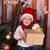 happy little boy in santas costume with the present near xmas tree stock photo © len44ik
