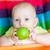 adorable baby eating apple in high chair stock photo © len44ik