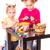 Two happy kids painting easter eggs. Happy Easter stock photo © Len44ik