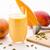 decorated mango milk shake and crushed cardamon stock photo © leowolfert