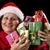 glimlachend · oude · vrouw · zeven · geschenken · blijde - stockfoto © leowolfert