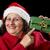 glimlachend · rijpe · vrouw · wijzend · kerstmis · geschenk · vrouwelijke - stockfoto © leowolfert