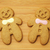 gingerbread man over wooden background stock photo © leungchopan