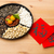 traditional lunar new year snack tray and chinese calligraphy m stock photo © leungchopan