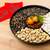 lunar new year snack tray and chinese calligraphy meaning for b stock photo © leungchopan