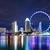singapore city skyline at night stock photo © leungchopan
