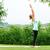 Lady is practicing half moon yoga pose in the nature stock photo © leventegyori