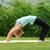 young woman doing bridge pose in yoga stock photo © leventegyori