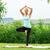woman doing tree vrksasana yoga pose meditating outdoors in nat stock photo © leventegyori