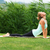 yoga bhujangasana cobra pose by woman on green grass in the park stock photo © leventegyori