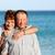 senior couple enjoying beach holiday stock photo © leventegyori