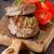 bifsztek · grillezett · zöldségek · vágódeszka · fa · asztal · felső - stock fotó © lidante