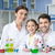 happy adult scientists and little girl student working together in chemical lab and smiling at camer stock photo © lightfieldstudios