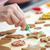 icing · christmas · cookies · glimlachende · vrouw · home · vrouw - stockfoto © lightfieldstudios