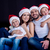 family in santa hats looking at camera stock photo © lightfieldstudios