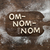 top view of edible lettering om nom nom made from cookies on wooden cutting board baking cookies co stock photo © lightfieldstudios