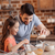 portrait of father and daughter making cookies in kitchen stock photo © lightfieldstudios