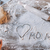 partial top view of child drawing heart symbol and word mom in flour on table mothers day concept stock photo © lightfieldstudios
