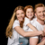 portrait of happy family in white t shirts hugging each other isolated on black stock photo © lightfieldstudios