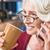 sorridente · atraente · maduro · óculos · copo - foto stock © lightfieldstudios