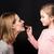 mother and daughter applying makeup stock photo © lightfieldstudios