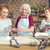 grandmother and granddaughter sifting flour stock photo © lightfieldstudios