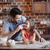 happy father and daughter having fun while cooking together stock photo © lightfieldstudios