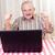como · idoso · homem · óculos · usando · laptop · casa - foto stock © lighthunter