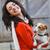 jonge · mooie · vrouw · liefhebbend · puppy · woonkamer · paar - stockfoto © lighthunter