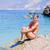 женщины · сидят · пляж · купальник · морем - Сток-фото © lighthunter