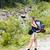 utazás · kirándulás · hölgy · nagy · hátizsák · hegyek - stock fotó © Lighthunter