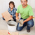 father and son laying floor tiles together stock photo © lightkeeper