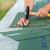 worker hands installing bitumen roof shingles stock photo © lightkeeper