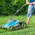 man mowing the lawn with blue lawnmower in summertime stock photo © lightkeeper