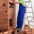 trabalhador · edifício · alvenaria · aquecedor · casa - foto stock © lightkeeper