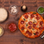 phases of making a pizza   the baked pizza ready to eat top vie stock photo © lightkeeper