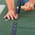 worker installs bitumen roof shingles   closeup stock photo © lightkeeper