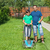 father and son mowing the lawn and trimming the edges together stock photo © lightkeeper