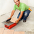 man cutting ceramic floor tiles with electric cutter stock photo © lightkeeper