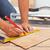Laying ceramic floor tiles - man hands closeup stock photo © lightkeeper