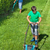 boy mowing the lawn with man trimming at the edges stock photo © lightkeeper