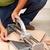 worker cutting ceramic floor tiles stock photo © lightkeeper