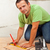 man laying ceramic floor tiles   measuring and cutting one piece stock photo © lightkeeper