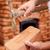 pedreiro · mãos · tijolo · martelo · alvenaria · aquecedor - foto stock © lightkeeper