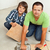 father and son mounting ceramic floor tiles together stock photo © lightkeeper