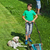 boy and his father mowing the lawn and trimming the hedge stock photo © lightkeeper