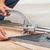 Worker cutting floor tiles with manual cutter stock photo © lightkeeper
